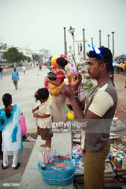 PONDICHERRY PUDUCHERRY INDIA A man selling toys at the waterfront of the former French colony of Pondicherry India