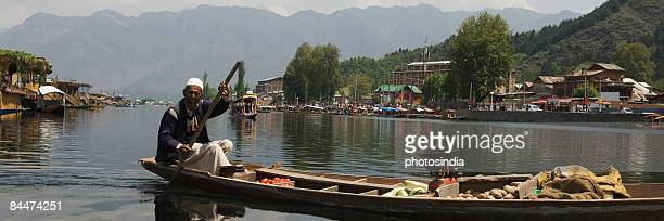 Man selling vegetable in a boat, Dal Lake, Srinagar, Jammu and Kashmir, India