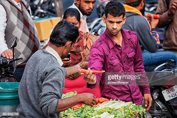 Man selling vegetables on the street in Old Delhi, India