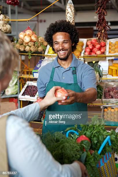 Man selling vegetables