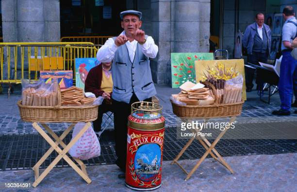 Man selling wafers at Plaza Mayor, Sol.