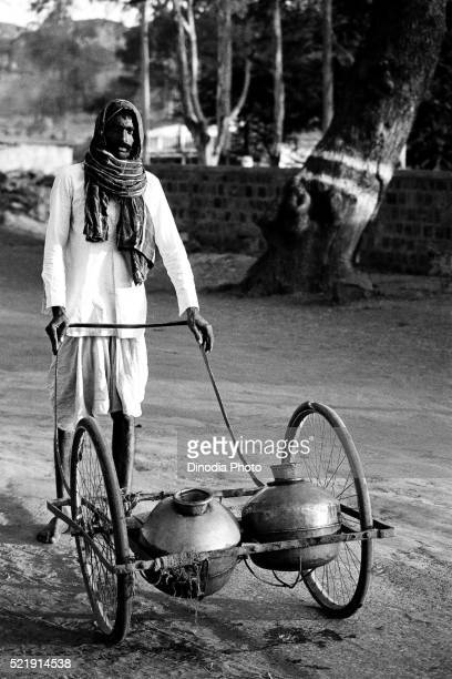man selling water in aluminium pots badami, karnataka, india, asia, 1985 - 1985 stock pictures, royalty-free photos & images