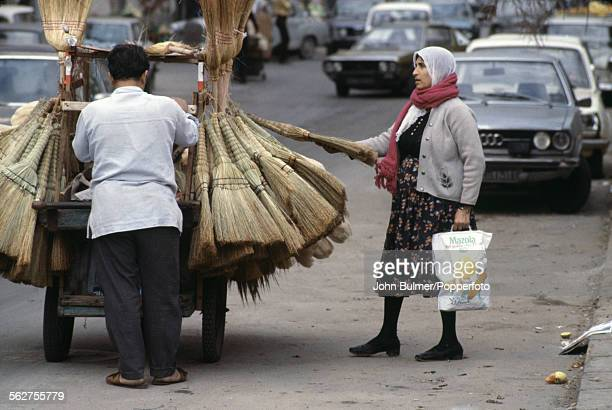 A man sellling brooms in Beirut Lebanon 1979