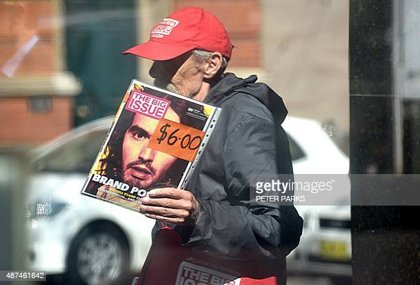 A man sells a copy of the Big Issue on a street in Sydney on September 10 2015 Australia's unemployment rate fell to 62 percent in August with...