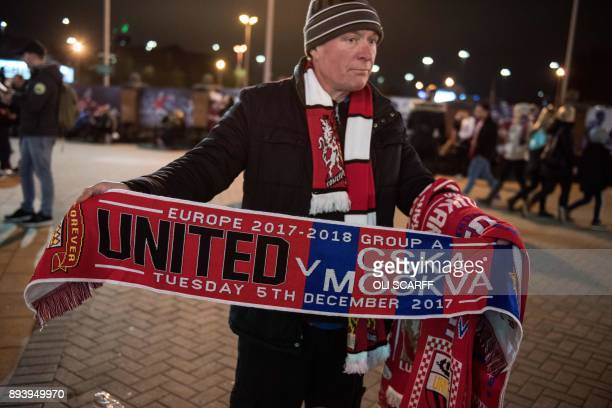 A man sells a souvenir scarf outside Old Trafford stadium prior to the UEFA Champions League group A match between Manchester United and CSKA Moscow...