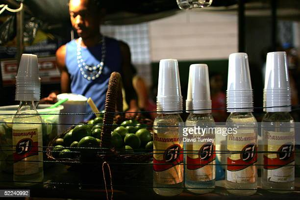 Man sells Brazilian Rum during Carnival on February 7, 2005 in Salvador, Brazil. Centuries of slave trade with Central and West Africa has left 40...