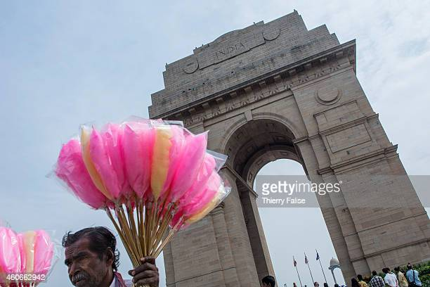 A man sells candy floss near the India Gate a war memorial dedicated to Indian soldiers who died during the First World War