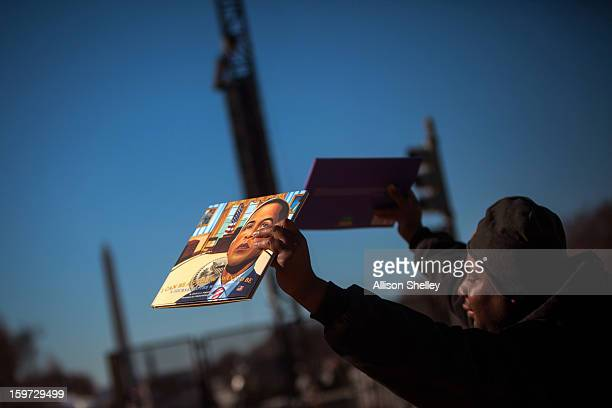 A man sells children's story books about US first lady Michelle Obama and US President Barack Obama on the National Mall January 19 2013 in...