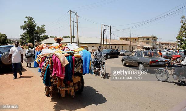 A man sells clothing in a cart along Ahmadu Bello way as normality returns after the religious violence that has engulfed Jos March 9 2010 Hundreds...