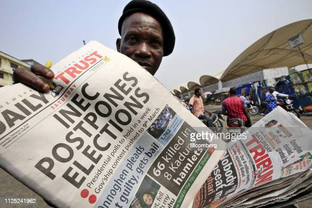 A man sells copies of the Daily Trust newspaper with a headline on the elections postponement in Lagos Nigeria Saturday Feb 16 2019 A lastminute...