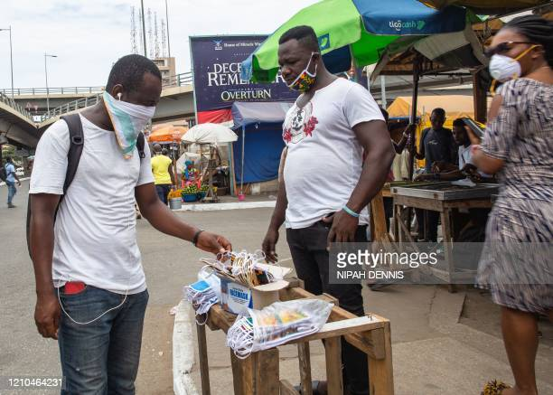 Man sells face masks after the partial lockdown in parts of Ghana to halt the spread of the COVID-19 coronavirus was lifted in Accra, Ghana on April...