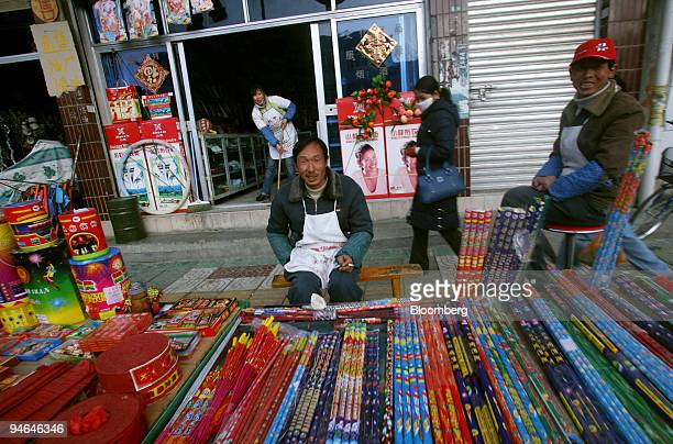 A man sells fireworks ahead of the Lunar New Year in the Tibetan town of Gyantse China on Saturday Feb 10 2007 The Year of the Pig will begin on...