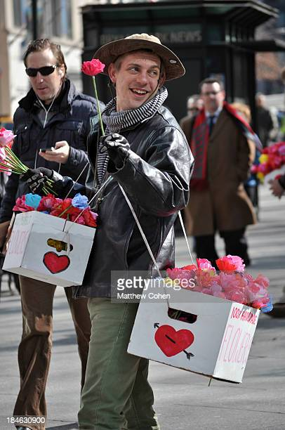 CONTENT] A man sells flowers outside of Bryant Park on Valentine's Day 2013