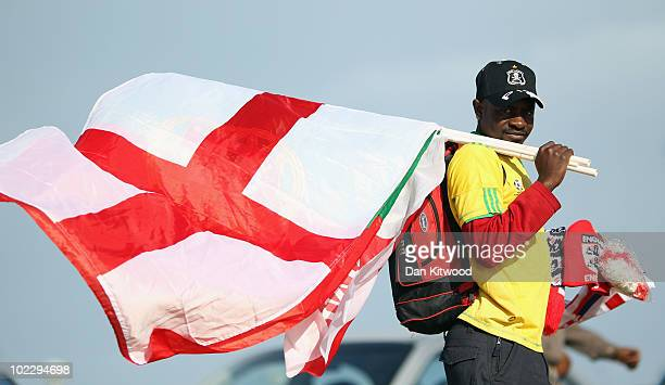 A man sells football merchandise next to the beach on June 22 2010 in Port Elizabeth South Africa England play Slovenia at the Nelson Mandela Bay...