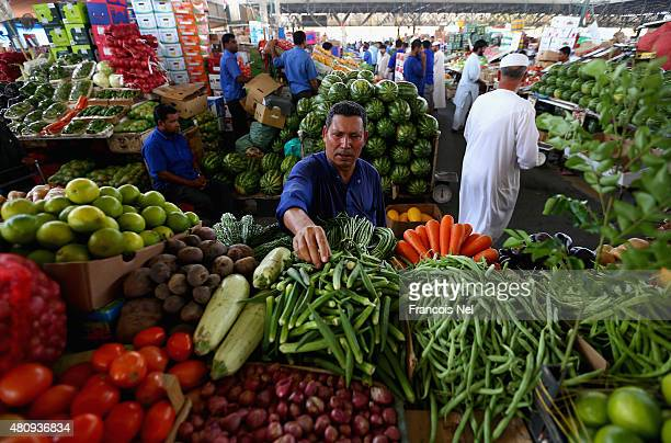 A man sells fruit and vegetables ahead of Eid celebrations on July 16 2015 in Dubai United Arab Emirates The Muslim holiday Eid marks the end of 30...