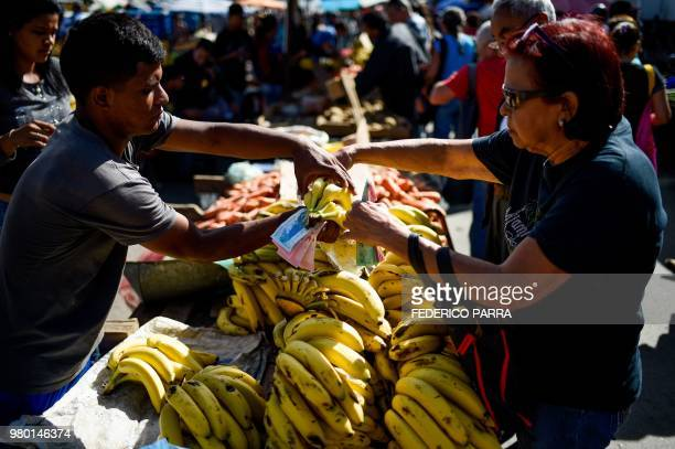 A man sells fruit at the municipal market of Coche a neighbourhood of Caracas on June 20 2018 Venezuelan President Nicolas Maduro ordered the...