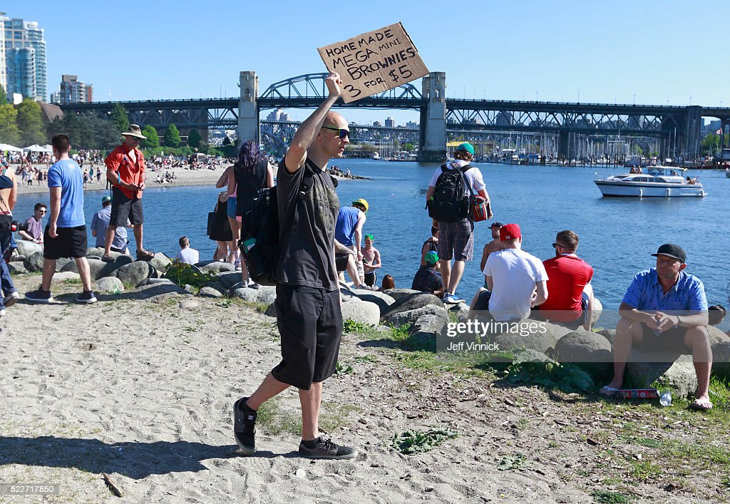 A man sells hash brownies as thousands of people gather at 4/20 celebrations on April 20, 2016 at Sunset Beach in Vancouver, Canada. The Vancouver 4/20 event is the largest free protest festival in the city, with day-long music, public speakers and the world's only open-air public cannabis farmer's market where people sell all kinds of cannabis and extracts while educating the crowd about medical marijuana, political involvement and activism. Canadian Federal Health Minister Jane Philpott says Canada will roll out the legislation in the spring of 2017 to begin the process of legalizing and regulating marijuana.