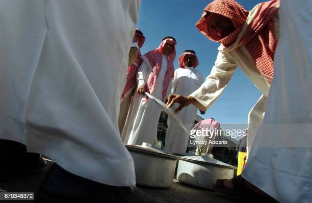 A man sells his honey at the Tuesday market in Ab'Ha Asseer Province Saudi Arabia December 17 2003 Thousands of religious extremists allegedly live...