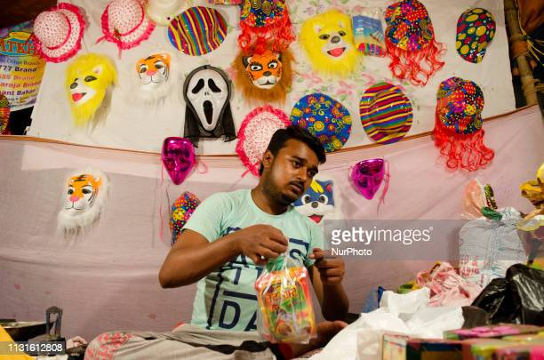 A man sells Holi celebration items as he also kept different masks in his background for the customers in Kolkata India on 19 March 2019 The Hindu...