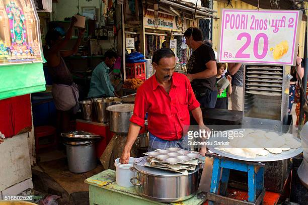 A man sells idli on the premises of Meenakshi temple in Madurai