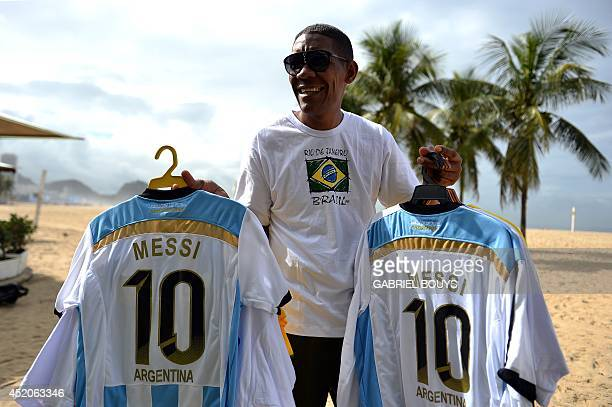 A man sells jerseys of Argentinian captain Lionel Messi on Copacabana beach in Rio de Janeiro on July 12 on the eve of the 2014 FIFA World Cup final...