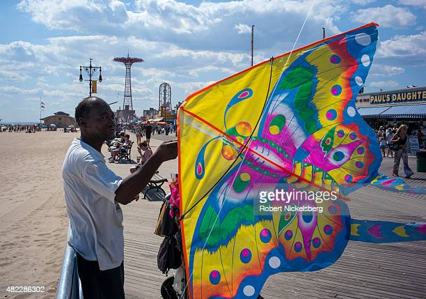 A man sells kites along the boardwalk July 24 2015 at Coney Island Beach in the Brooklyn borough of New York