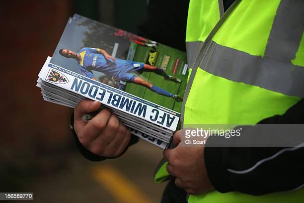A man sells match programmes outside AFC Wimbledon's stadium before the npower League Two match between AFC Wimbledon and Aldershot Town at the...