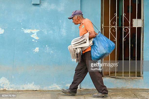 A man sells newspapers on the street in Havana's center Since the 24th May the Cuban Government legalized small and mediumsized private businesses in...
