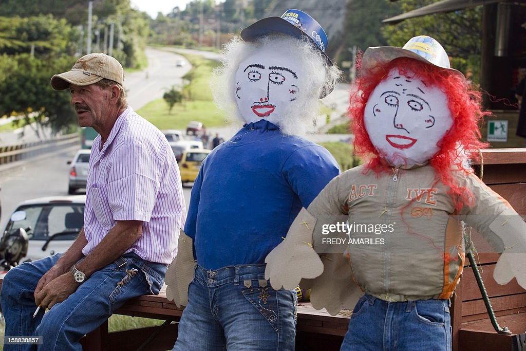 A man sells 'Old Year' dolls on the outskirts of Medellin, Colombia, on December 31, 2012. It is a popular tradition in Colombia to burn 'Old Year' dolls on the last night of the year. AFP PHOTO/Fredy AMARILES