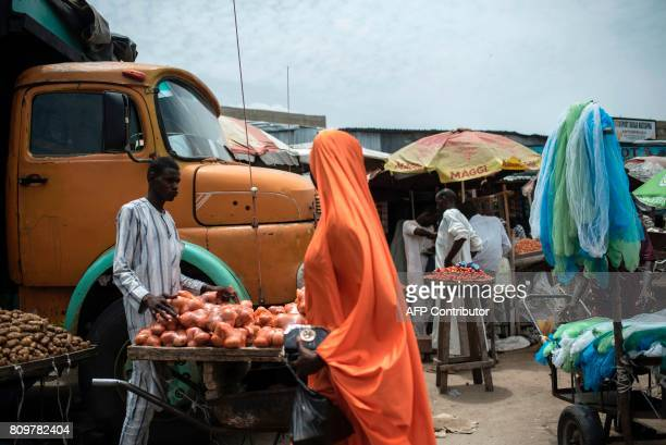 A man sells onions at the MondayMarket one of the biggest markets in Maiduguri in northeastern Nigeria on July 4 2017 Due to the Boko Haram...