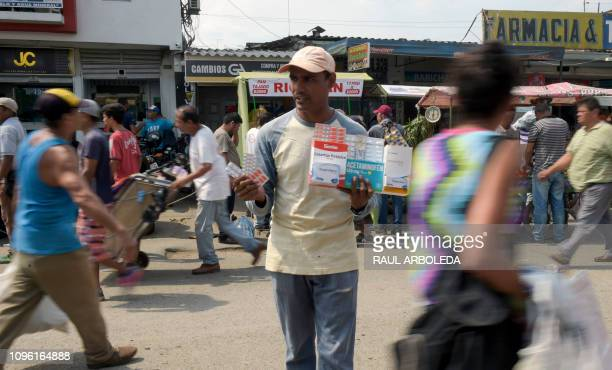 A man sells painkillers and antibiotics in Cucuta Colombia near the Simon Bolivar International Bridge in the border with Tachira Venezuela on...