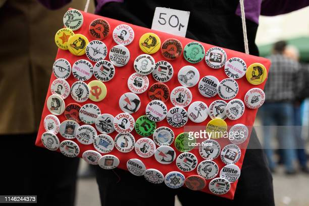 A man sells pin badges as British Union members take part in the Labour Day March on May 1 2019 in London England The Labour Day March through...