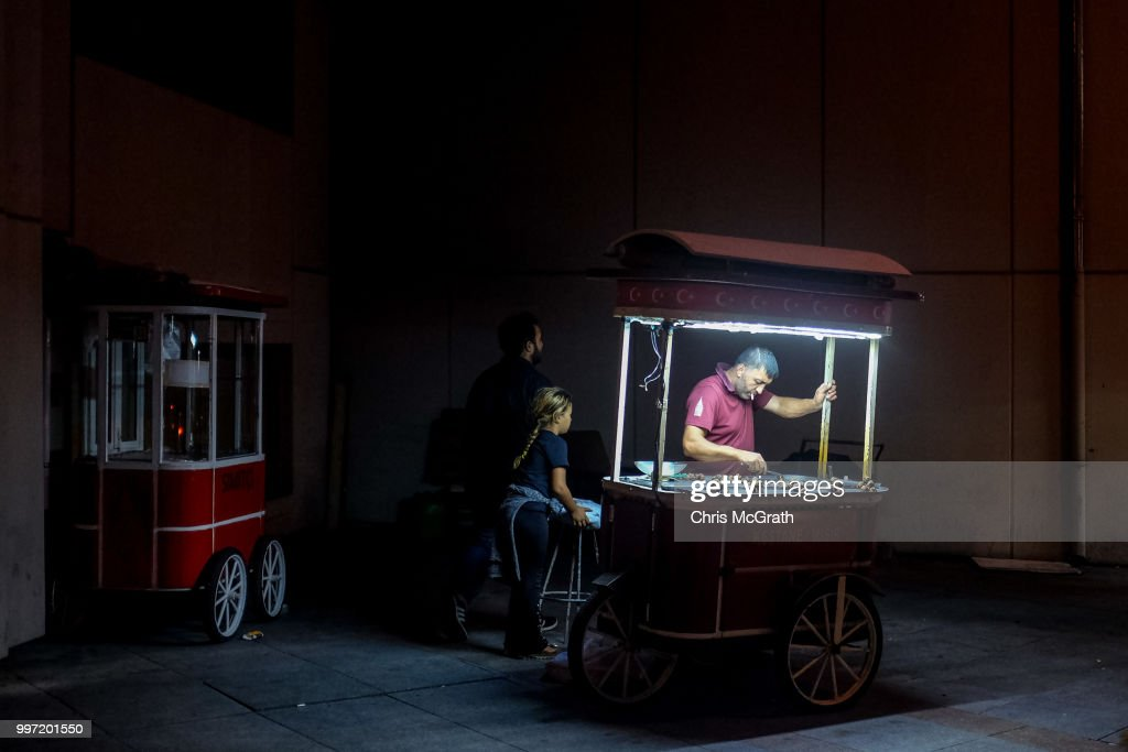 A man sells roasted chestnuts from a cart in Taksim Square on July 12, 2018 in Istanbul Turkey. Following Turkey's President Recep Tayyip Erdogan's re-election victory and the appointment of his son-in-law Berat Albayrak to lead the Treasury and Finance Ministry fears are growing that Turkey's economy is heading into crisis . The Turkish Lira, has plunged by approximately one-fifth this year raising prices for businesses and households.