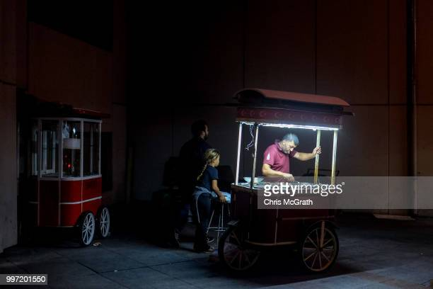A man sells roasted chestnuts from a cart in Taksim Square on July 12 2018 in Istanbul Turkey Following Turkey's President Recep Tayyip Erdogan's...