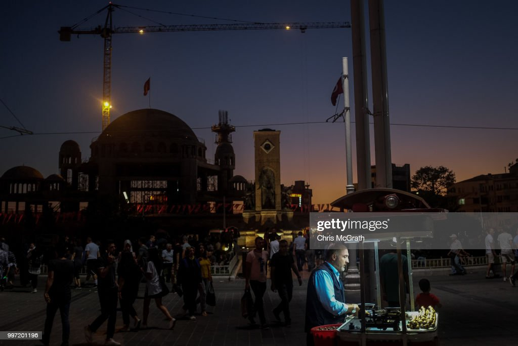 A man sells roasted chestnuts in front of the controversial Taksim Square Mosque on July 12, 2018 in Istanbul Turkey. Following Turkey's President Recep Tayyip Erdogan's re-election victory and the appointment of his son-in-law Berat Albayrak to lead the Treasury and Finance Ministry fears are growing that Turkey's economy is heading into crisis . The Turkish Lira, has plunged by approximately one-fifth this year raising prices for businesses and households.