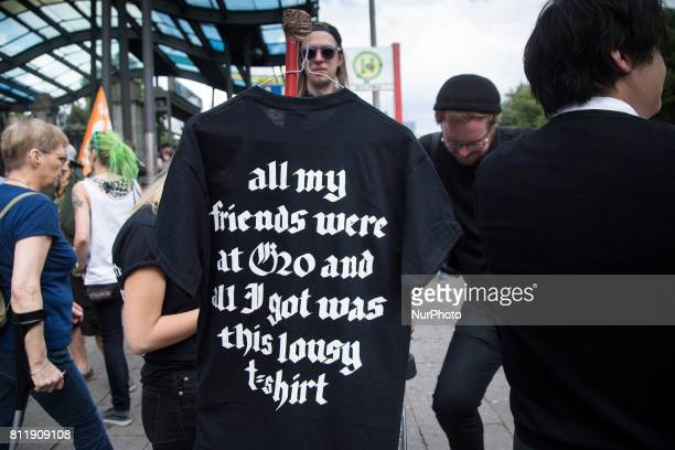 Man sells souvenir tshirt during G 20 summit in Hamburg on July 8 2017