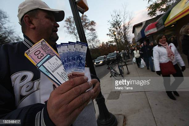 A man sells tickets to the Penn State vs Nebraska football game in the wake of the Jerry Sandusky scandal on November 11 2011 in State College...