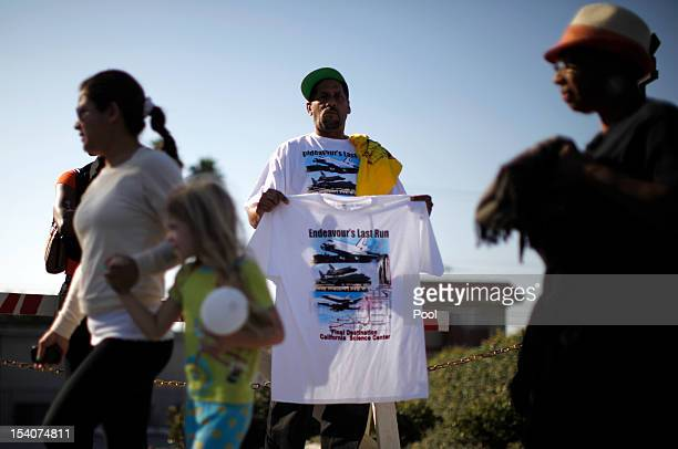A man sells tshirts as the Space Shuttle Endeavour is moved to the California Science Center on October 13 2012 in Inglewood California The space...