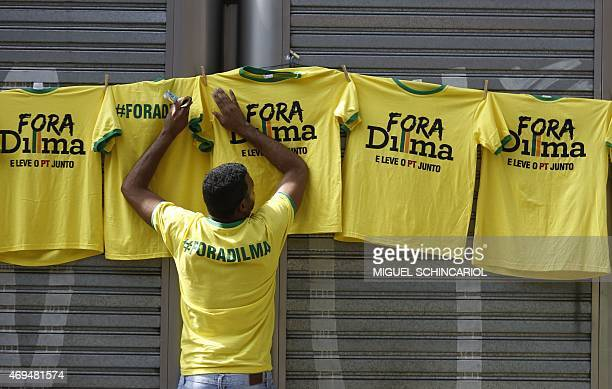 A man sells Tshirts reading Dilma out during a protest against the government of Brazilian President Dilma Rousseff in Sao Paulo Brazil on April 12...