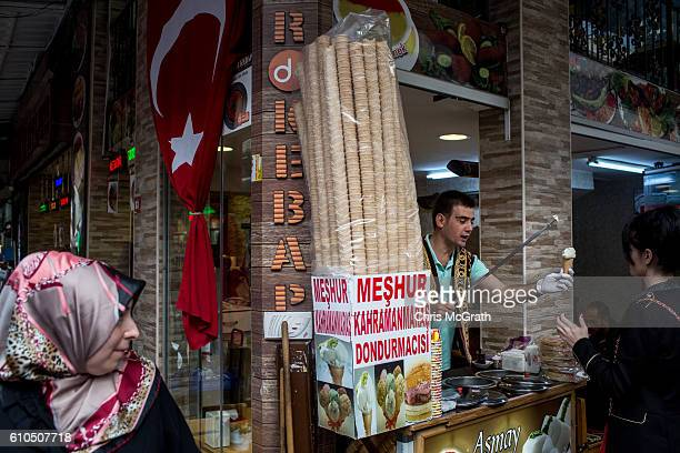 A man sells Turkish ice cream to a customer on a market street in Eminonu on September 26 2016 in Istanbul Turkey Credit rating agency Moody's...