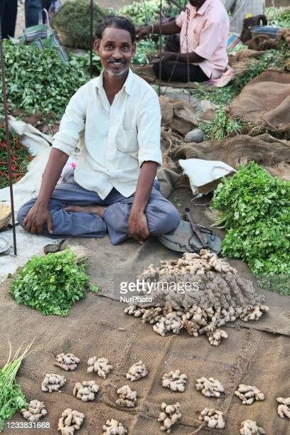 Man sells turmeric and coriander at the Shaniwaar Subzi Bazaar, which is the largest fruit and vegetable market in the Indian city of Nagpur,...