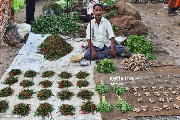 Man sells turmeric, chilies and coriander at the Shaniwaar Subzi Bazaar, which is the largest fruit and vegetable market in the Indian city of...