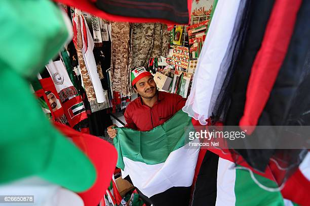A man sells UAE National Day clothing and accessories ahead of the 45th UAE National Day on November 30 2016 in Dubai United Arab Emirates