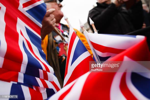 Man sells Union Jack flags amid Brexit celebrations in Parliament Square in London, England, on January 31, 2020. Britain's exit from the European...