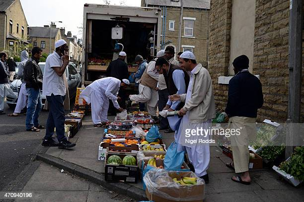 A man sells vegetables on the street outside the Masjid Noorul Islam mosque during a visit by the Respect Party's George Galloway on April 24 2015 in...