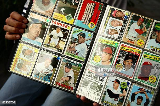 A man sells vintage baseball cards prior to the start of the last game at Yankee Stadium between the Baltimore Orioles and the New York Yankees on...