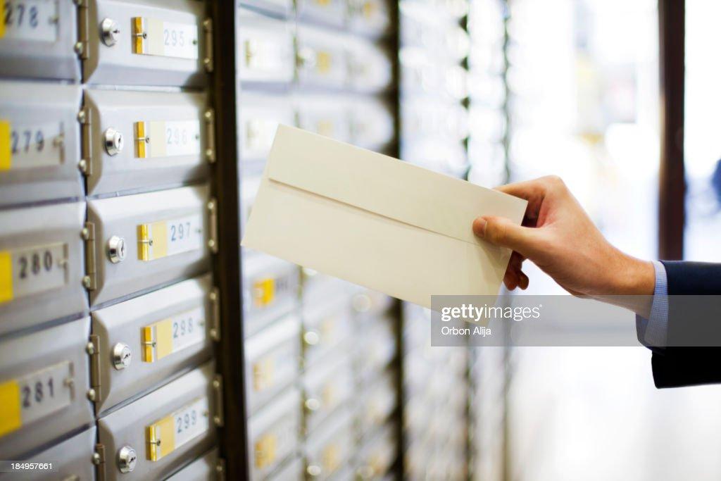 Man sending a letter : Stock Photo