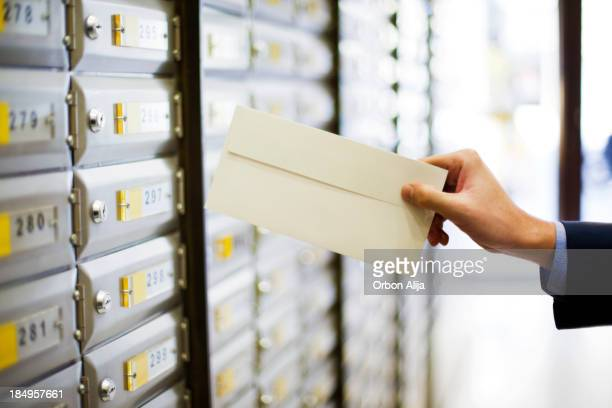man sending a letter - message stock pictures, royalty-free photos & images