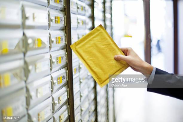 man sending a package - mail stock pictures, royalty-free photos & images