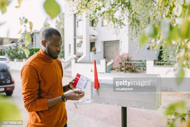 man sending voting ballot - voting by mail stock pictures, royalty-free photos & images
